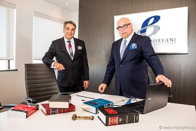 Gerard Borean and Donato Parente at a desk - Parente Borean LLP Barristers and Solicitors in Vaughan, Ontario